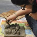 Art-pitara_participant-working-on-their-molela-tiles